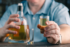 Man offers whiskey. Elegant man keeps and holds a glass Stock Photos