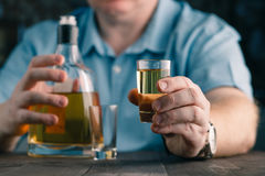 Man offers whiskey. Elegant man keeps and holds a glass Royalty Free Stock Image