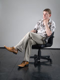 Man in office armchair Royalty Free Stock Images
