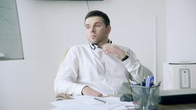 A man in the office in a bad mood stock video