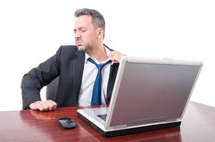 Man at office being hot or sick pulling tie Royalty Free Stock Photography
