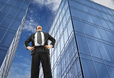 Man and office buildings. Businessman in front of office buildings Royalty Free Stock Image