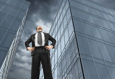 Man and office buildings Stock Image