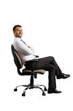 Man in office chair Royalty Free Stock Photo