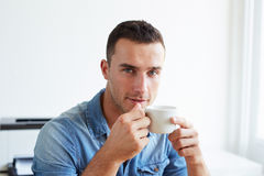 Man in the office with coffee cup Stock Images