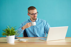 Man in office drinking coffee Stock Photos