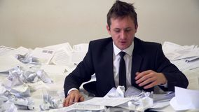 The man in the office drowning in paper.  stock video