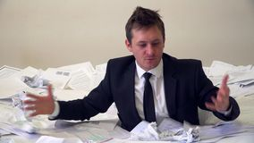 The man in the office drowning in paper.  stock video footage
