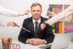 Man at the office having a lot of work Stock Photos