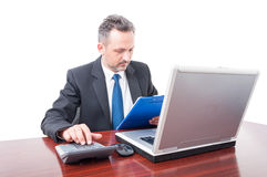 Man at office holding clipboard and calculating. Man wearing suit at office holding clipboard and calculating isolated on white background Stock Photo