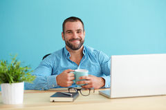 Man in office with a mug Stock Photo