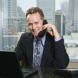 Man on office phone Royalty Free Stock Image
