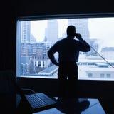 Man on office phone Stock Image