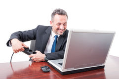 Man at office plugging in electricity wire Stock Photography