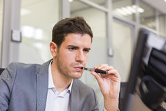 A man in office smoking with electronic cigarette Royalty Free Stock Photography
