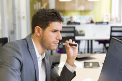 A man in office smoking with electronic cigarette Stock Photography