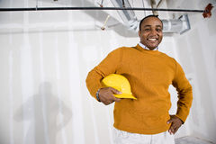 Man in office space ready for buildout. African American man in commercial office space ready for buildout Royalty Free Stock Images