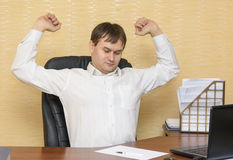 The man  in the office stretches Stock Photos
