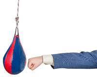 Man in office suit punches punching bag isolated Stock Image