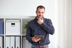Man in office with tablet computer Royalty Free Stock Photo