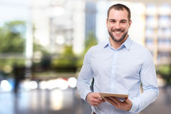 Man in office with tablet computer Stock Photo