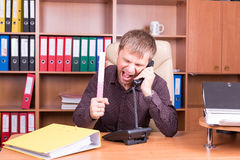 Man in office talking on phone Stock Photo
