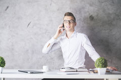 Man in office talking on phone Royalty Free Stock Photography