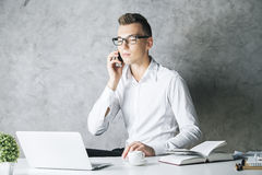 Man in office talking on phone Stock Images
