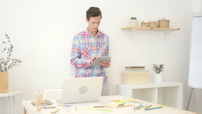 Man in office using electronic tablet , creative designer , agency stock video