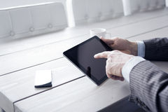 Man in the office using tablet pc Stock Photo