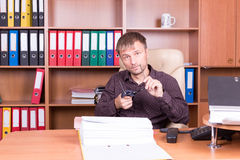 Man in office wipes glasses Royalty Free Stock Images