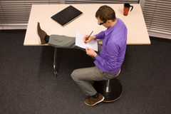 Man at office work - stretching leg Royalty Free Stock Photo