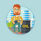 Man with oil barrel and gas pump nozzle. Hipster caucasian man standing near oil barrel. Oil worker holding gas pump nozzle on a city background. Oil industry Royalty Free Stock Photos