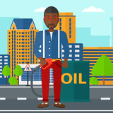 Man with oil can and filling nozzle. An african-american man standing beside the oil can and holding filling nozzle on a city background vector flat design Royalty Free Stock Photos