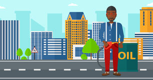 Man with oil can and filling nozzle. An african-american man standing beside the oil can and holding filling nozzle on a city background vector flat design Stock Images