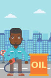 Man with oil can and filling nozzle. An african-american man standing beside the oil can and holding filling nozzle on a city background vector flat design Stock Photos