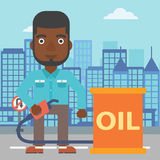 Man with oil can and filling nozzle. An african-american man standing beside the oil can and holding filling nozzle on a city background vector flat design Royalty Free Stock Photography