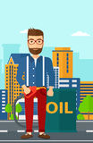 Man with oil can and filling nozzle. A hipster man with the beard standing beside the oil can and holding filling nozzle on a city background vector flat design Royalty Free Stock Images