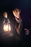 Man with oil lamp Stock Photography