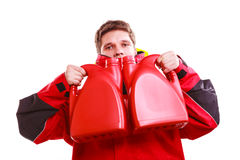 Man in oilskin with bottle. Stock Photography