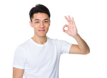 Man with ok sign gesture. Isolated on white background Royalty Free Stock Photography