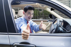 Man with OK sign inside car Royalty Free Stock Image