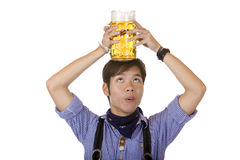 Man with Oktoberfest beer stein on head Royalty Free Stock Photo