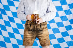 Man with Oktoberfest beer stein and leather pants Stock Photography