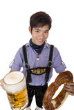 Man with Oktoberfest beer stein (Mass) and pretzel Stock Photos