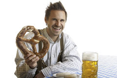Man with Oktoberfest Pretzel and Beer Stein (Mass) Stock Photography