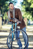 Man with old bike Royalty Free Stock Photos