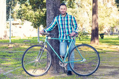 Man with old bike Stock Photography