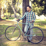 Man with old bike Stock Images