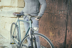Man with old bike. With vintage style stock photography